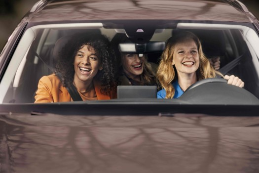 Low res-Woman driving with female friends